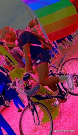 Abstract - man on bike flying rainbow pride flag