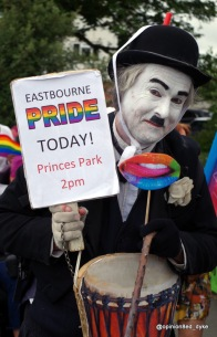 Charlie Chaplin at Pride- holding an Eastbourne Pride sign