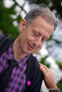 a hand on Peter Tatchell's shoulder
