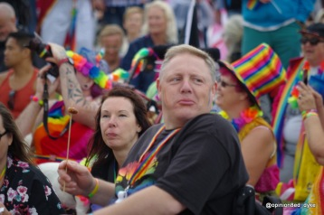 guy holding a sausage on a stick at Eastbourne Pride